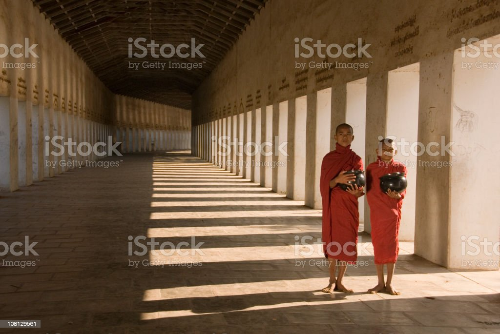 Two novice monks walking in the morning royalty-free stock photo