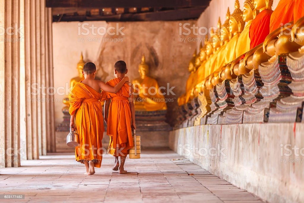 Two novices walking return and talking in old temple - foto de stock