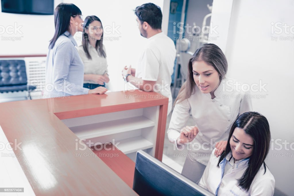 Two Nurses Work While the Doctor Talks to New Dental Students for their Professional Practice stock photo