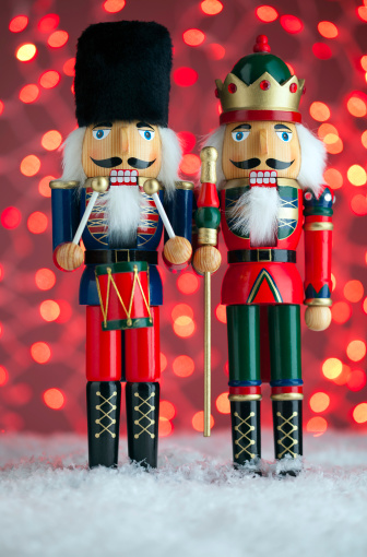 Two Nutcrackers with Red Lights Vertical