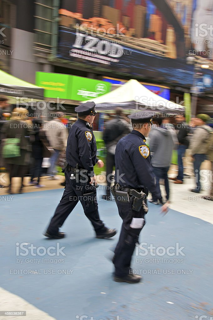 Two NYPD officers patrol in Times Square, Manhattan, NYC stock photo
