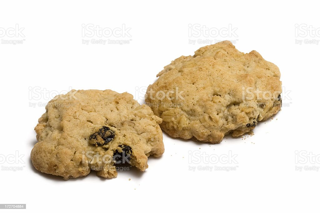 Two oatmeal raisin cookies stock photo