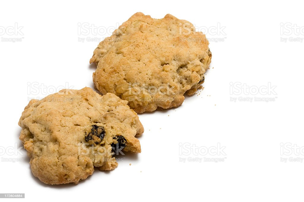 Two oatmeal raisin cookies royalty-free stock photo
