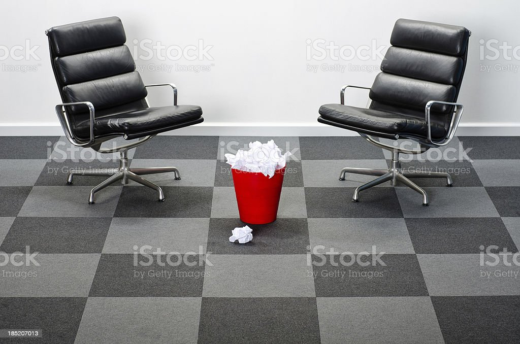Two Office Chairs With Red Waste Basket royalty-free stock photo