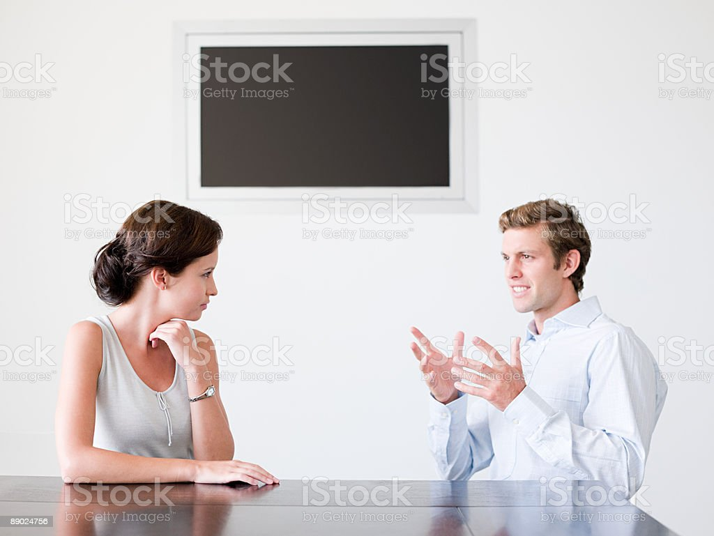 Two office colleagues talking royalty-free stock photo