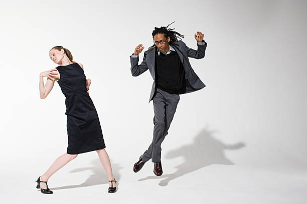 Two office workers dancing stock photo