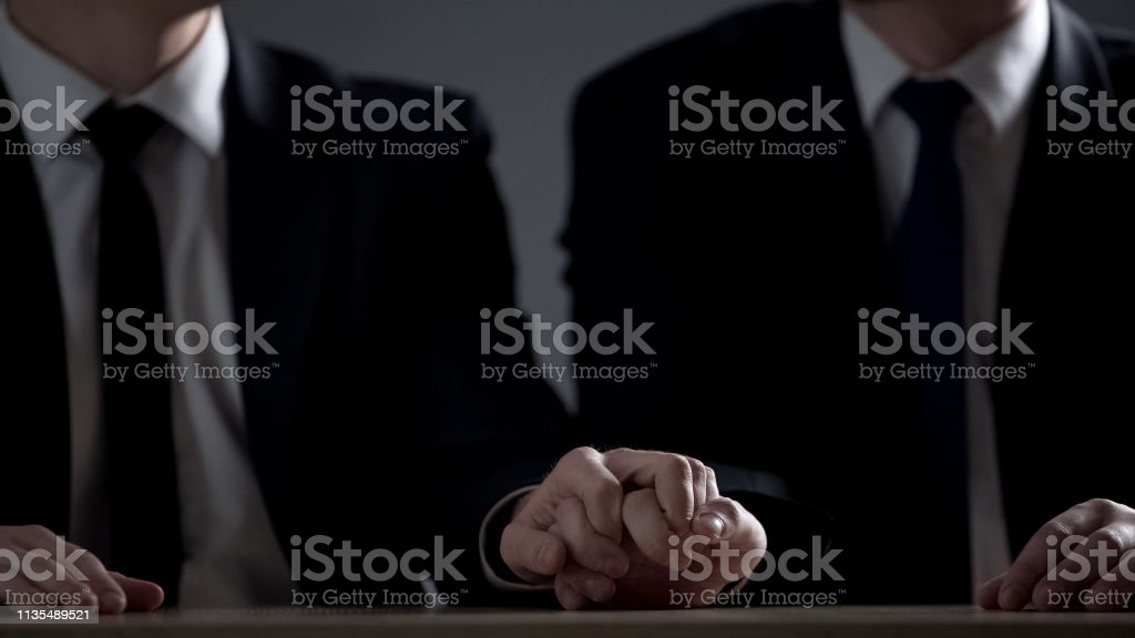 Two official men holding hands, homosexual relations for moving up...