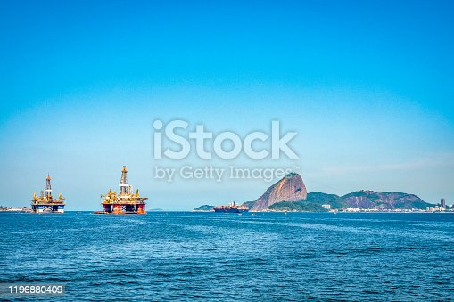Platforms anchored in Guanabara Bay, Rio de Janeiro Cargo ship leaving Rio de Janeiro Sugarloaf in the background