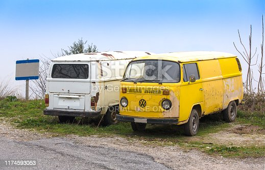 Pelion mountain, Greece, Volos - April15, 2018: Two old and grunge Volkswagen Beetle vintage van cars parked side by side on a mountain road
