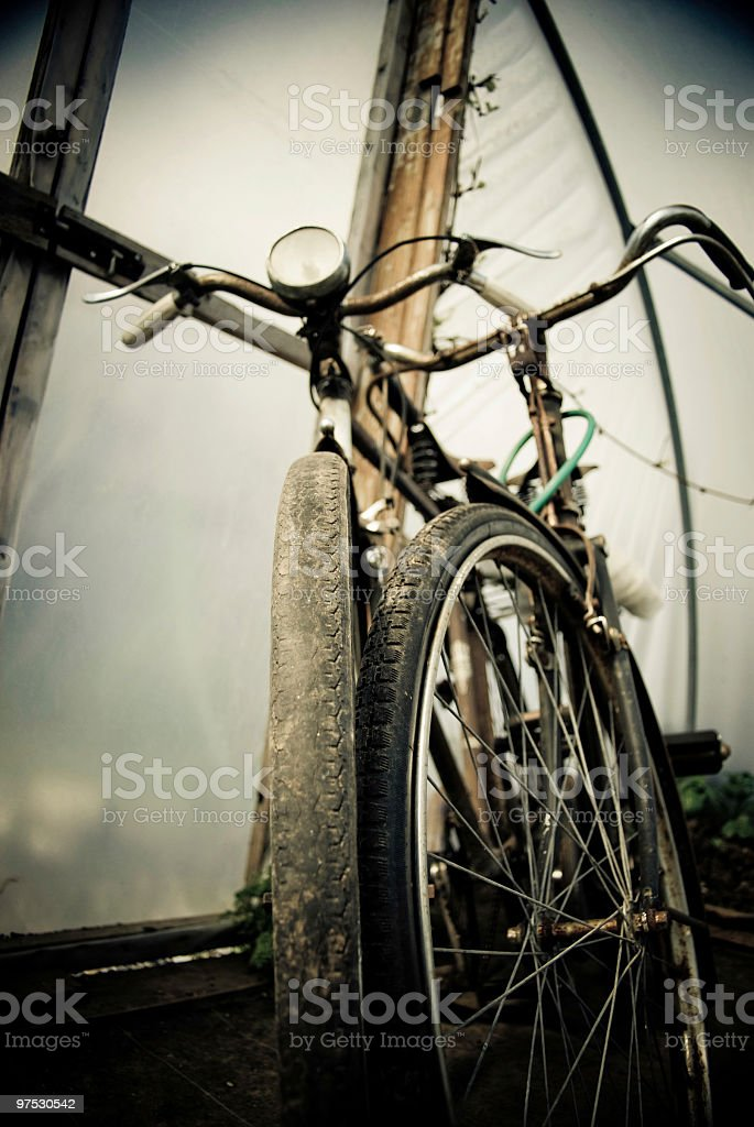 Two old bicycles in shed royalty-free stock photo