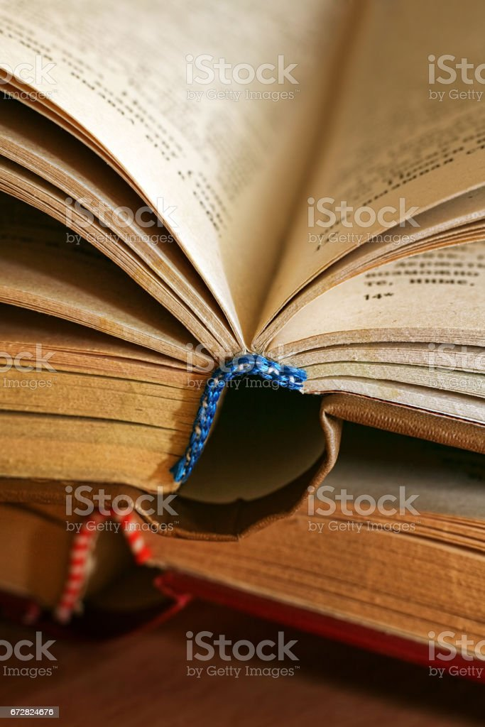 Two old books close up. With use of a macro-ring stock photo