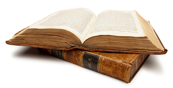 Two Old Books, One open. White Background, Clipping Path.