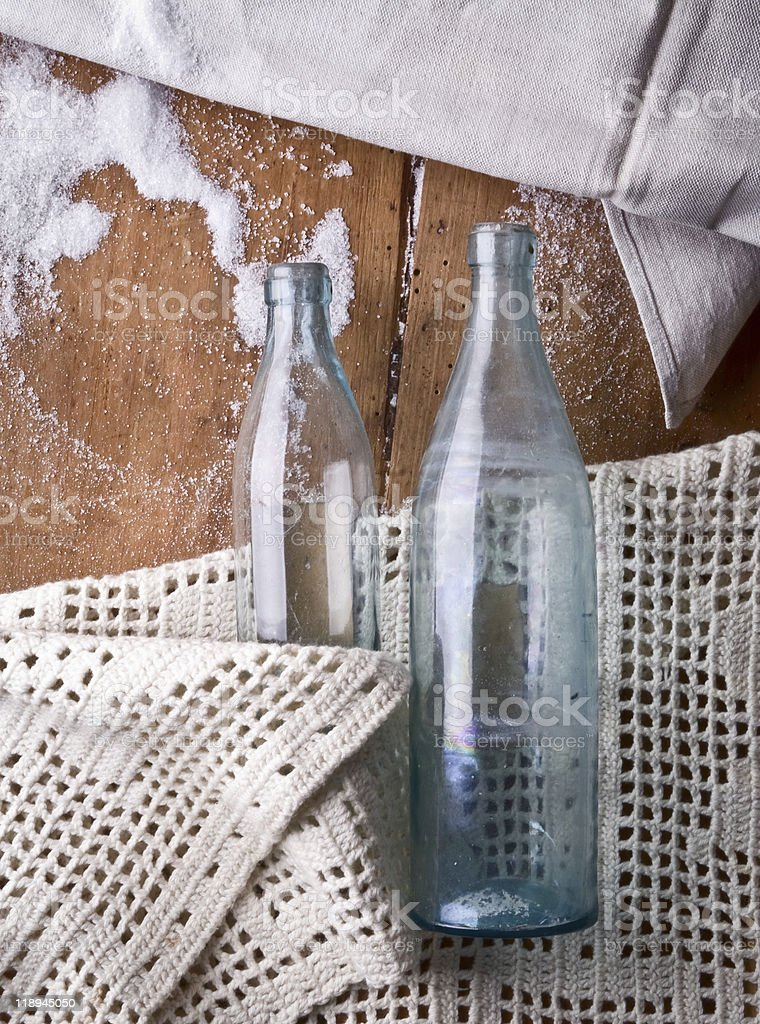 Two old bottles on a wooden background royalty-free stock photo