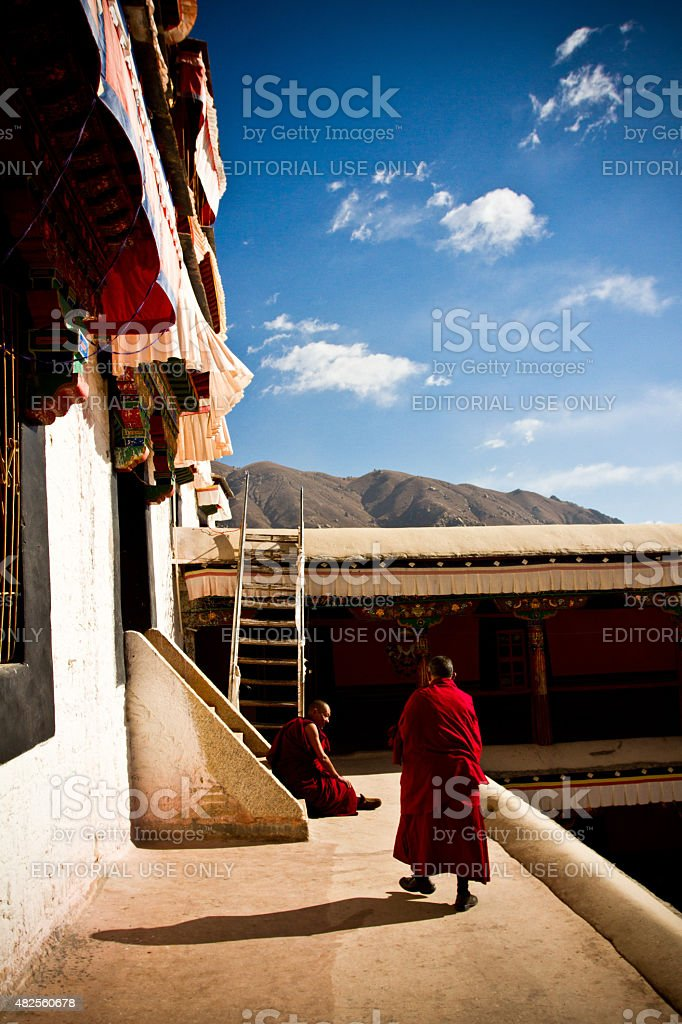 Two old Buddhist monks of Lhasa, Tibet with clouds stock photo