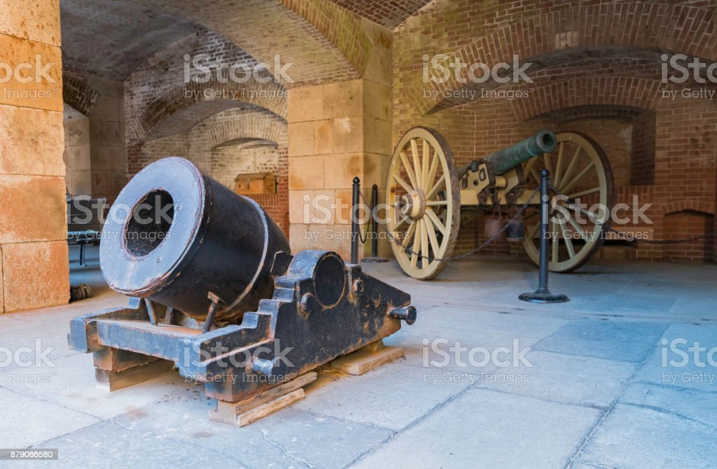 Two old cannon in Fort Point building stock photo