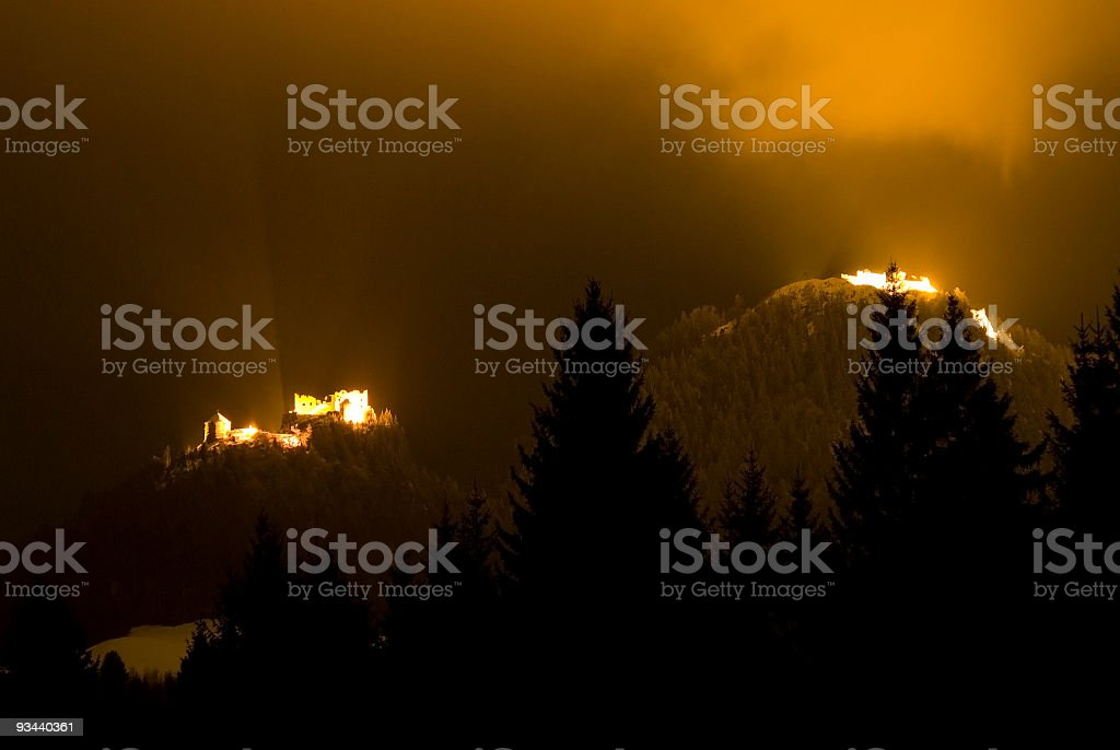 Two old castles in the night stock photo