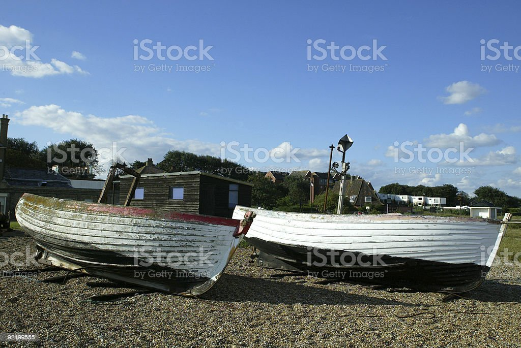 Two old fishing boats on beach Suffolk England royalty-free stock photo