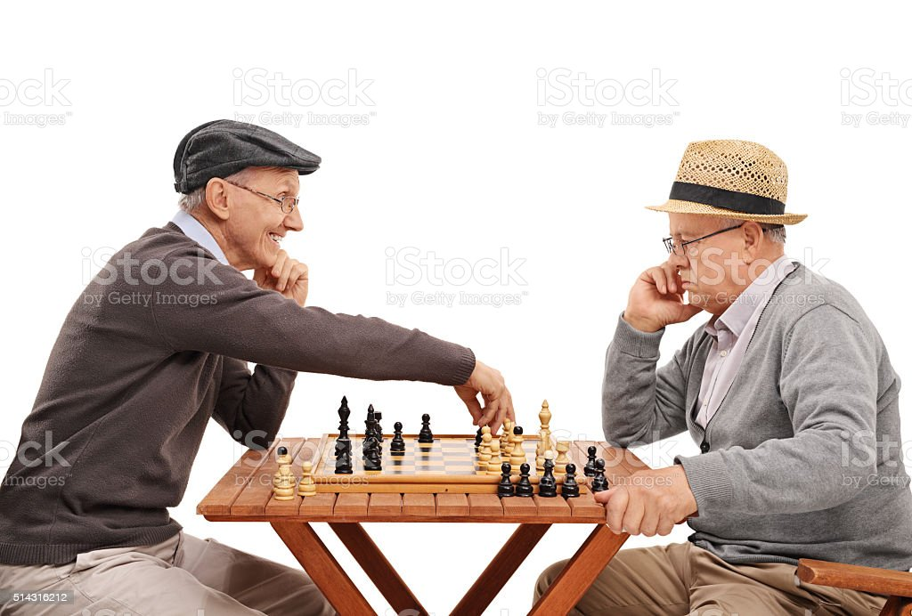 Two old friends playing a game of chess stock photo