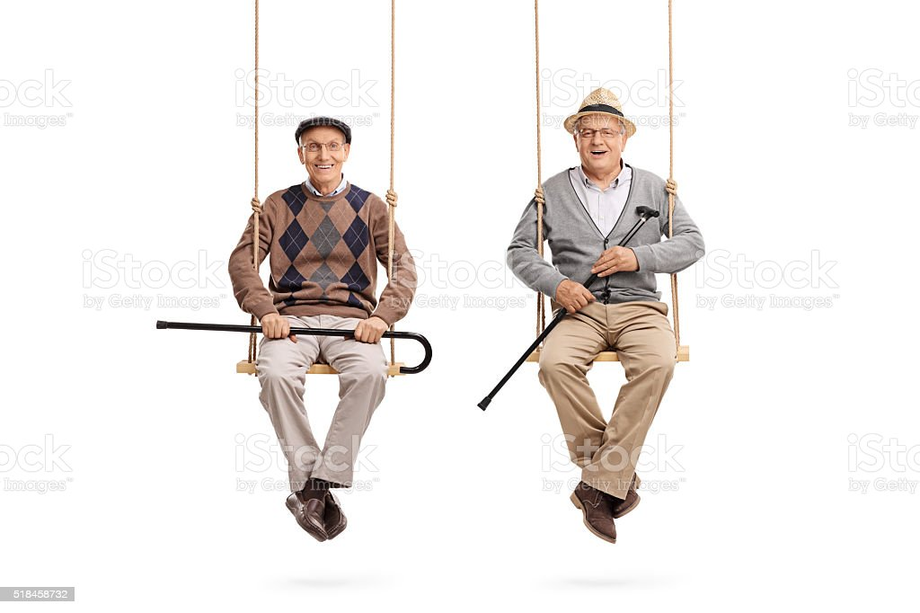 Two old friends sitting on wooden swings stock photo