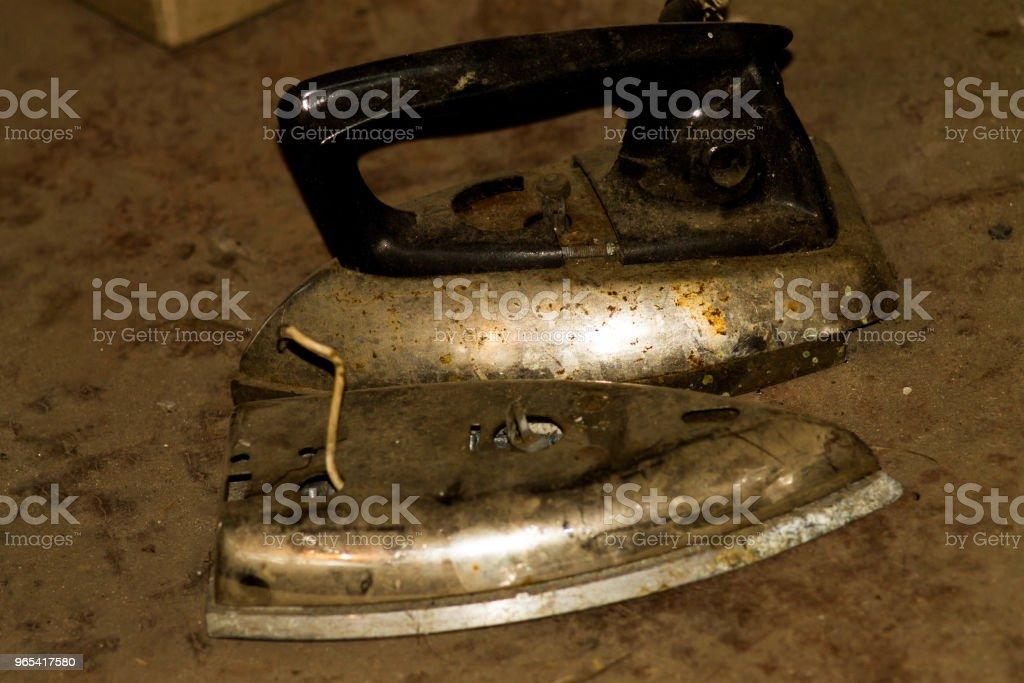 Two old irons in the garage. Soviet time zbiór zdjęć royalty-free