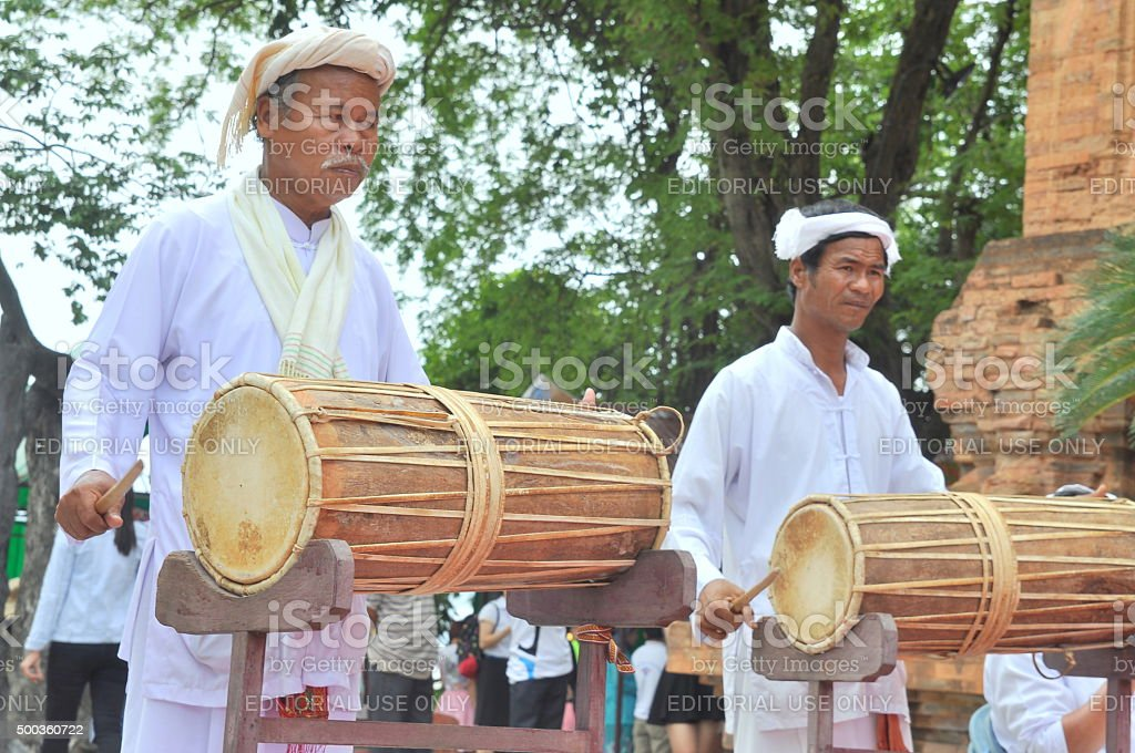 Two old men are performing the traditional drums technique stock photo