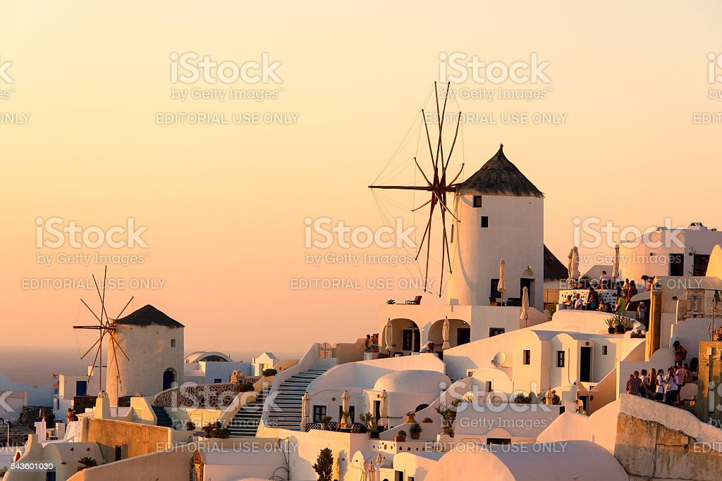 Two  old mills and old houses on Santorini island at sunset stock photo