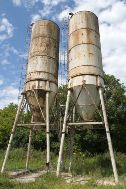 Two old rusted silos stock photo