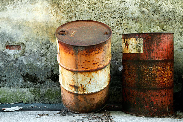 Two old rusty barrels stock photo