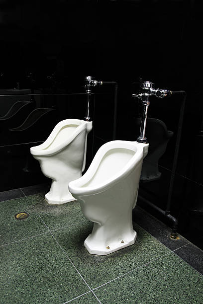 two old urinals stock photo