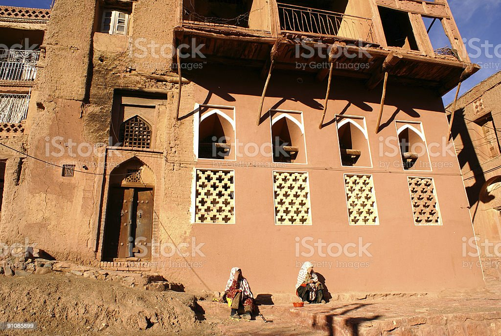 Two old women near house royalty-free stock photo