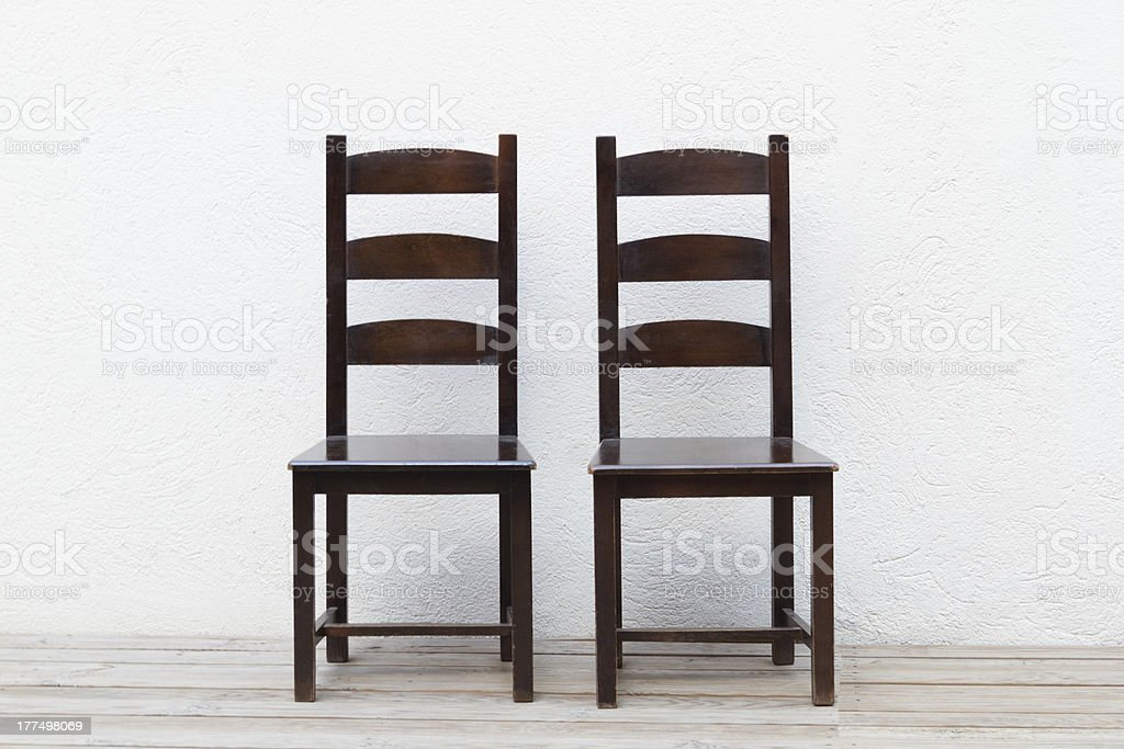 Two old wooden chairs stock photo