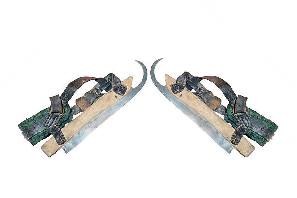 two old wooden ice skates - dutch hockey stockfoto's en -beelden