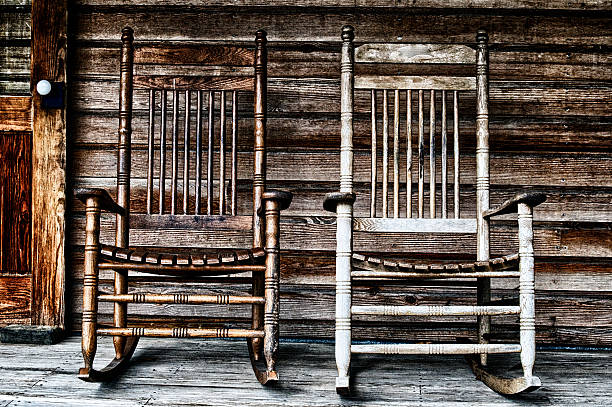 two old wooden rocking chairs stock photo