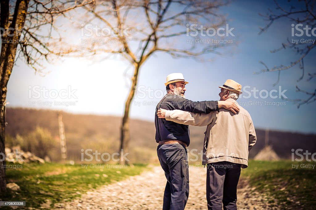 Two older gentlemen who have been best friends for very long stock photo
