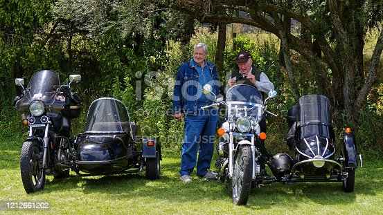 Tapawera, Tasman/New Zealand – January 14, 2012: Two older guys with their motorcycle and sidecars, Tapawera A & P (agricultural and pastoral) show. Non ticket community organized event.
