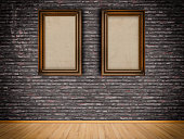 Two old-fashioned frames on the brickswall.