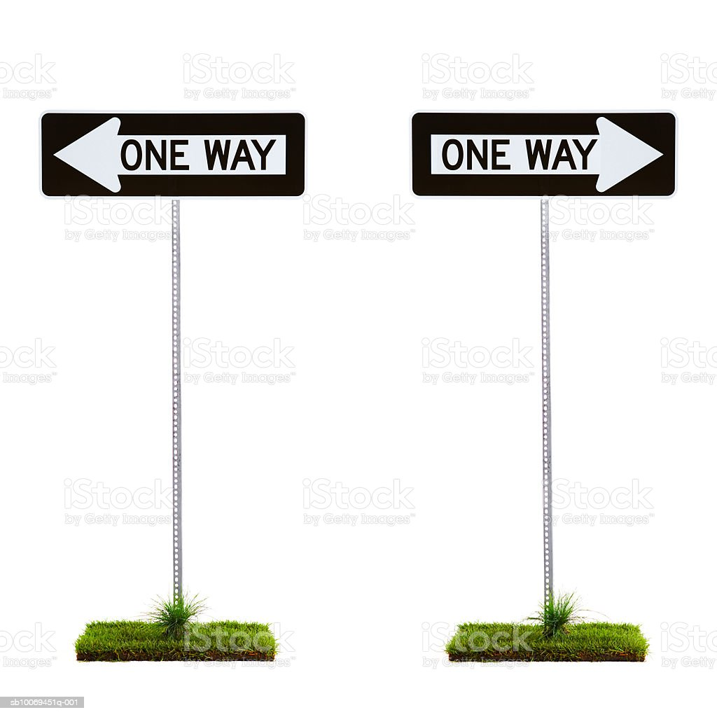 Two one way signs pointing to opposite directions royalty-free stock photo