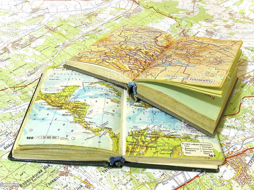Two opened old atlas book on the spread map stock photo