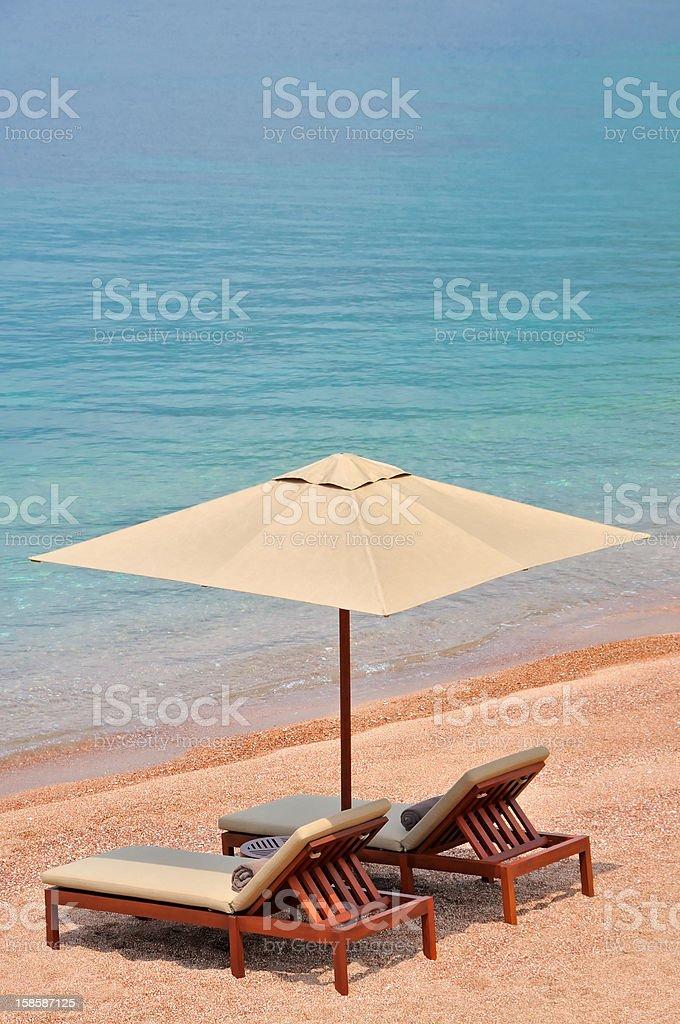 Two Orange Beach Chairs and Umbrella royalty-free stock photo