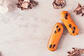 istock Two orange glazed eclairs on white marble table 862079750