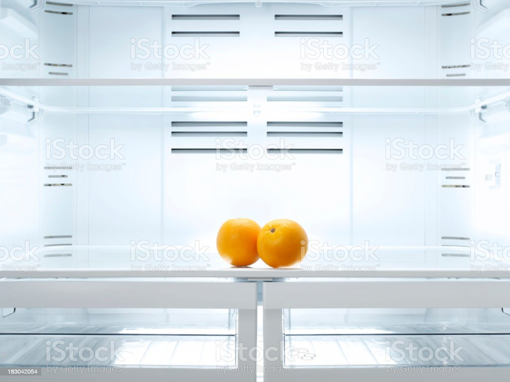 Two oranges in the refrigerator royalty-free stock photo