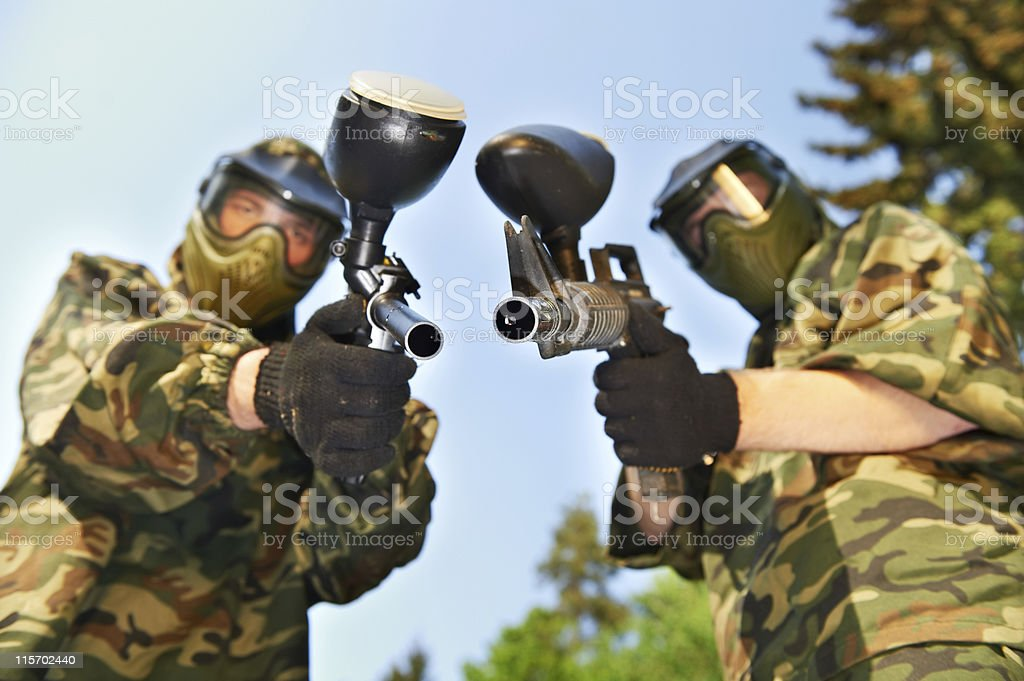 Two paintball players stock photo