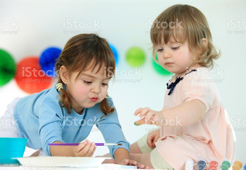 Two painting toddlers royalty-free stock photo