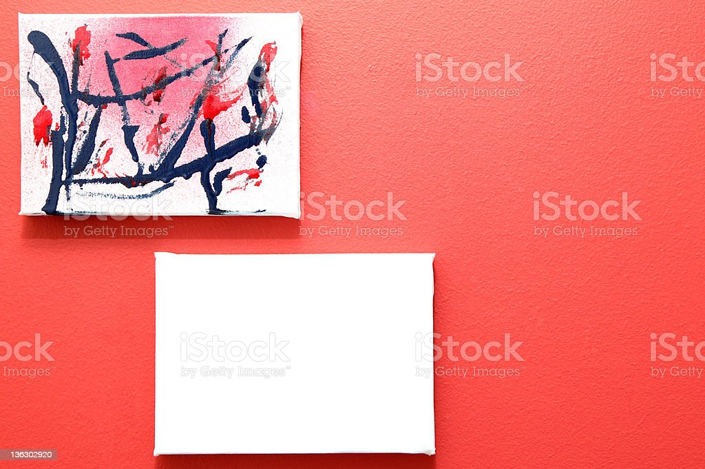 two paintings on a red wall royalty-free stock photo