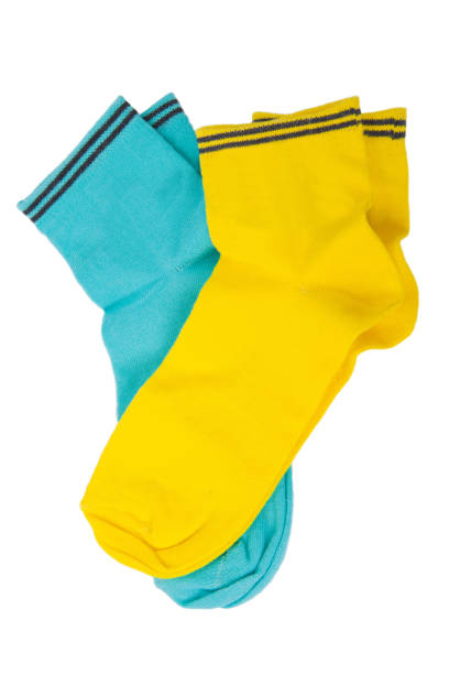 Two pair of blue and yellow socks isolated on white stock photo