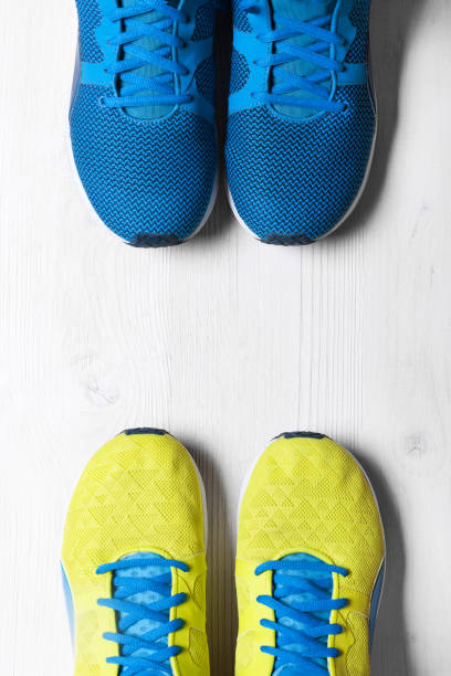 Two Pair of blue and yellow sport shoes  background stock photo