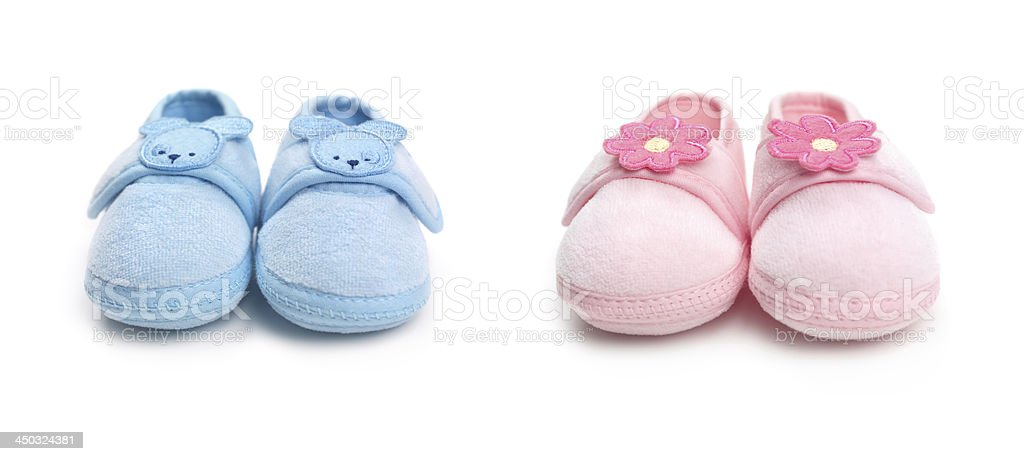 Two pairs of baby boy and girl shoes stock photo