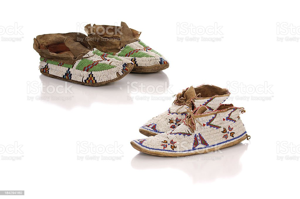 Two Pairs Of Old Beaded Moccasins stock photo