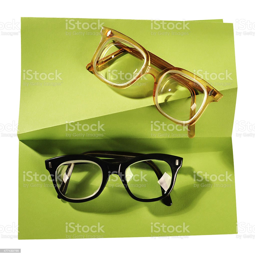 Two pairs of retro eyeglasses on creative support. stock photo