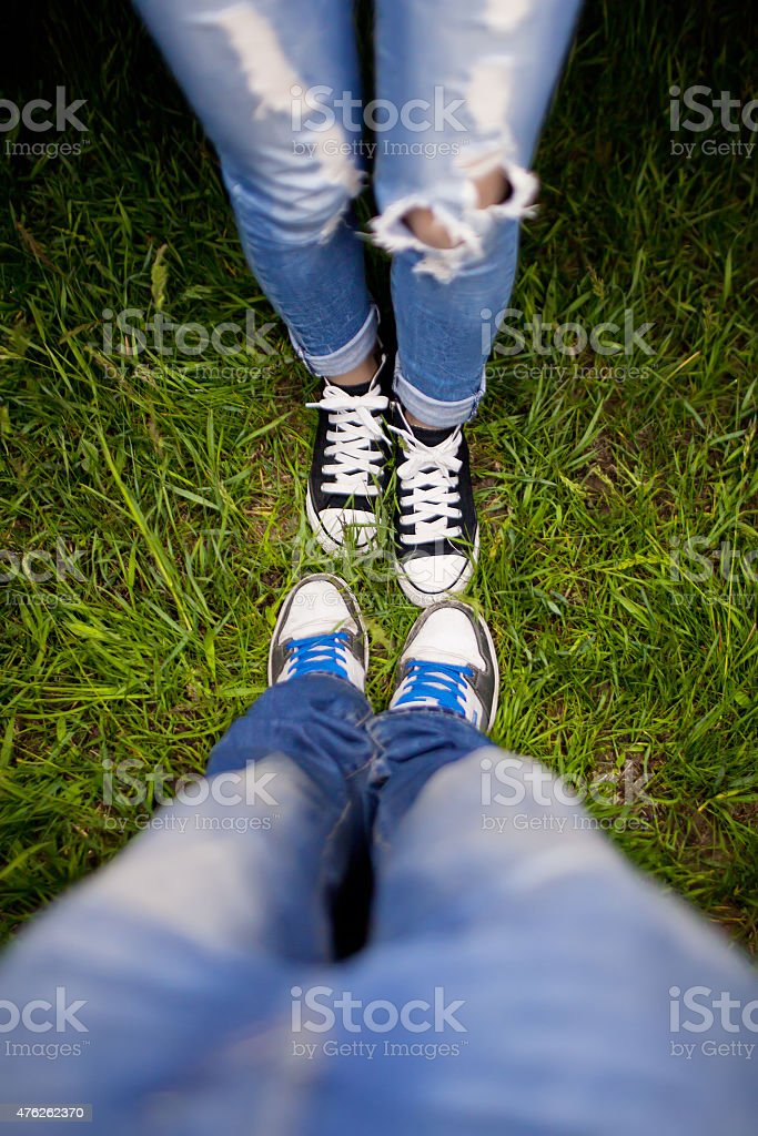 Two pairs of shoes on a green meadow stock photo